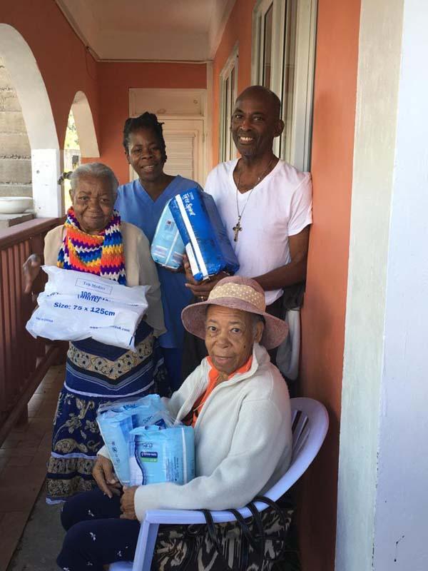 Sineku Trust Charity resumes visit to Dominica despite COVID